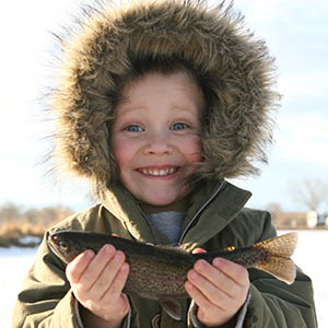 Little boy shows off his catch. iStock