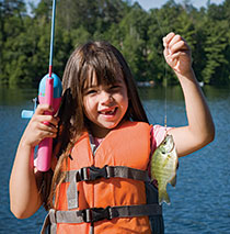 Little girl shows off her catch. iStock