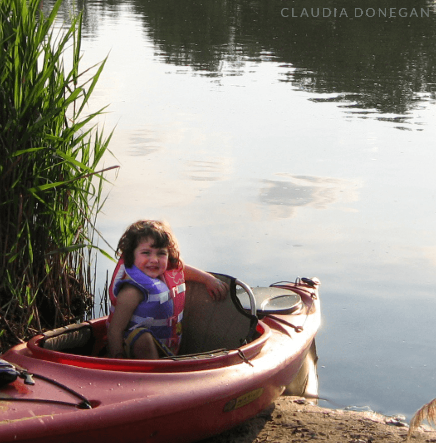 Little girl sitting in a kayak